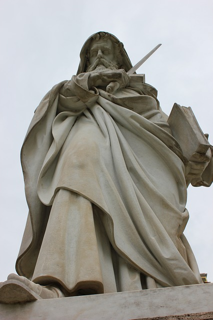 A statue of St. Paul wielding a sword. He is holding a book in his left hand.