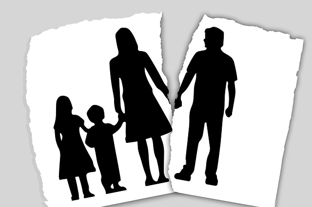 A black and white illustration showing a family holding hands together. Everyone in it is represented as a silhouette. Unfortunately, the image is torn. The husband that was once holding hands with his wife is torn from the rest of the image.