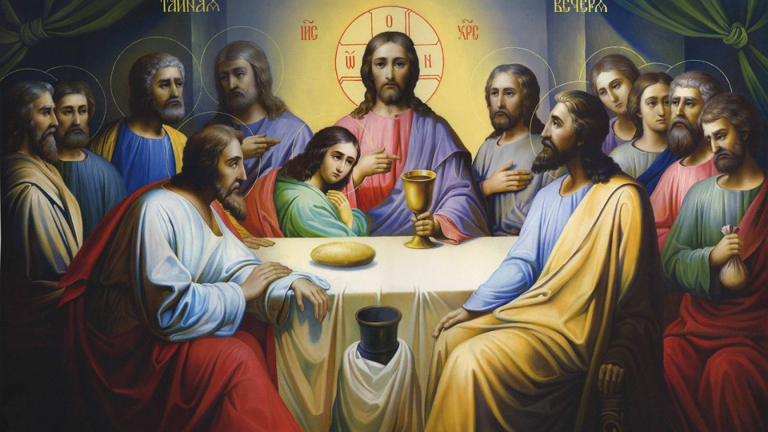An image of Jesus sitting at the Last Supper with His disciples. John is resting at His side. The painting is interesting because the supper has not started yet. The bread has not been broken, and the juice is still in its goblet.