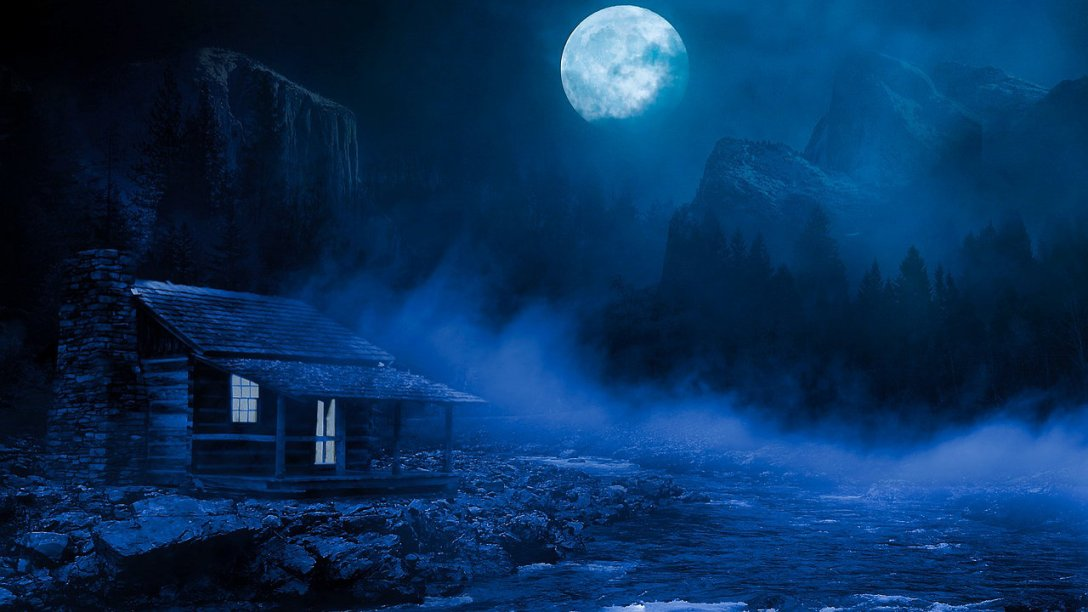 In the dark of night a small log cabin can be seen in the bottom left corner of the image. Its lights are on, but nobody is visible from the outside. A river is near the house. Rolling fog is over the water. The moon stands watch near the top of picture.