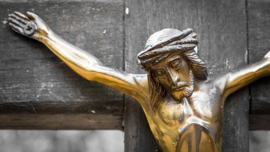 A sculpture showing the body of Jesus hanging from the cross.