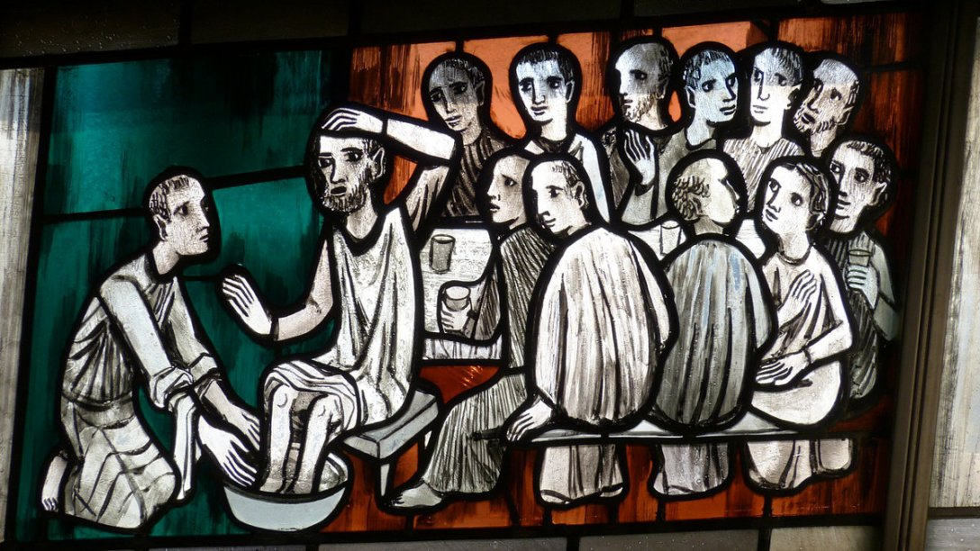 An illustration of Jesus washing the feet of the apostles.