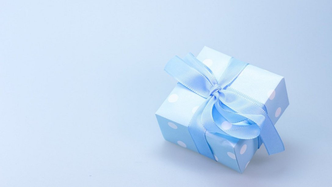 A gift wrapped in a white box.
