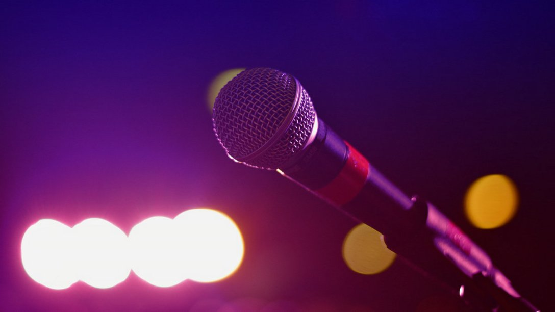 A microphone with bright lights in the background.